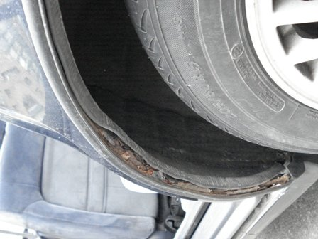 Rust Repair Estimates-driver-side-rear-wheel-well.jpg